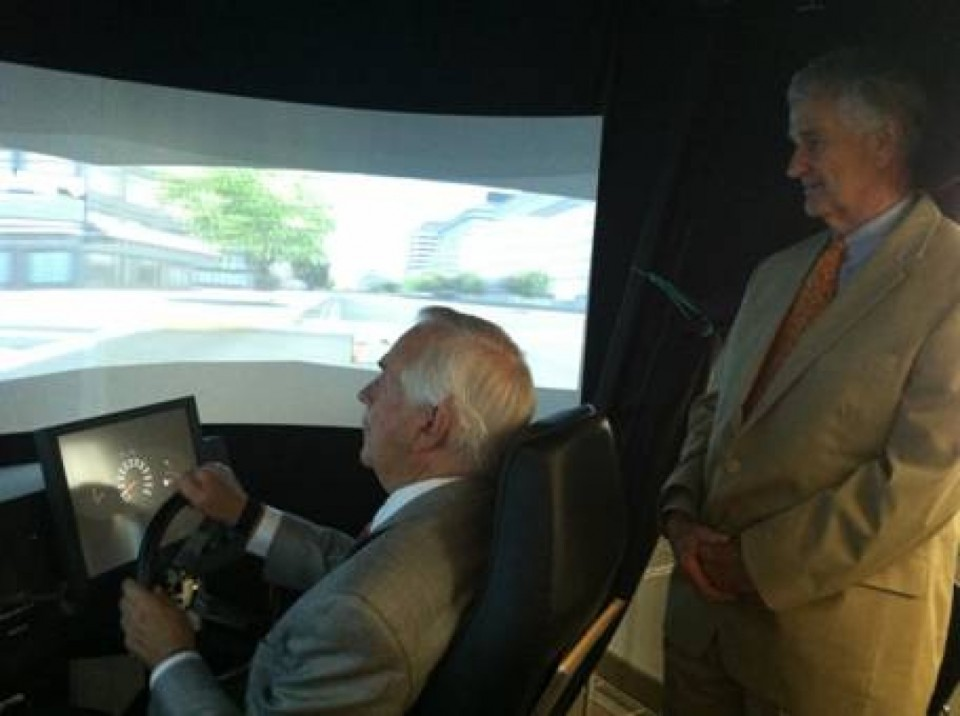 drive simulator delegates Tom Rust and Joe May